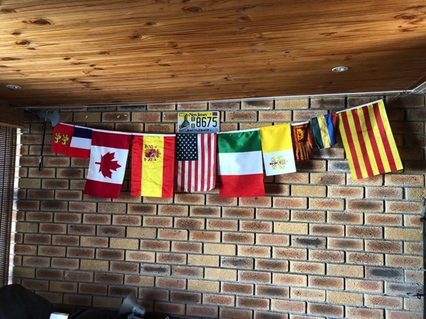 Selection of flags hanging on a wall