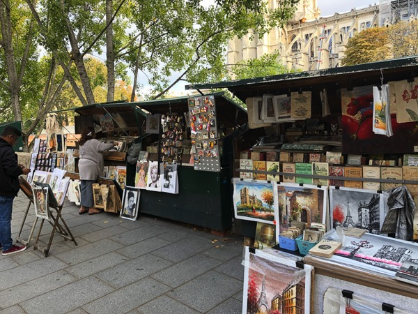 The image shows a line of stalls with books displayed for sale.