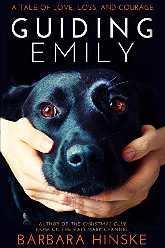the image shows the cover of the book Guiding Emily; the cover is a beautiful black Labrador