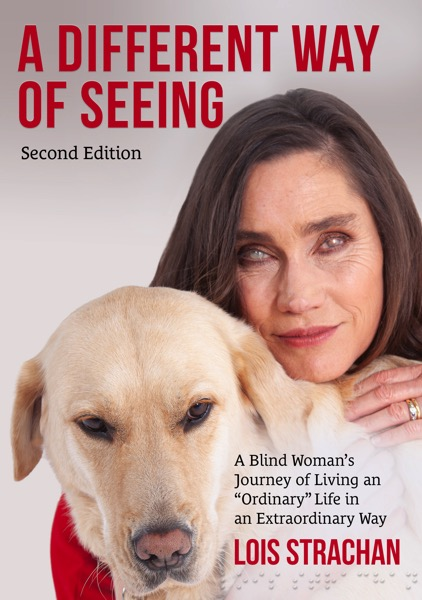 the image shows a book cover, with Lois hugging Fiji and the text A Different Way of Seeing (second edition): A Blind Woman's Journey of Living an Ordinary Life in an Extraordinary Way