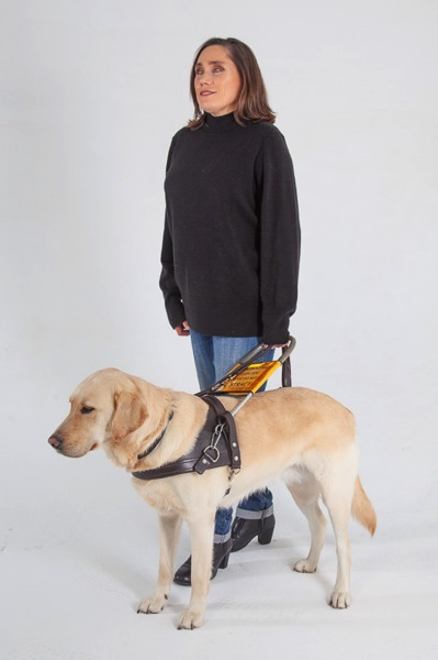 The image shows Lois walking with guide dog Fiji