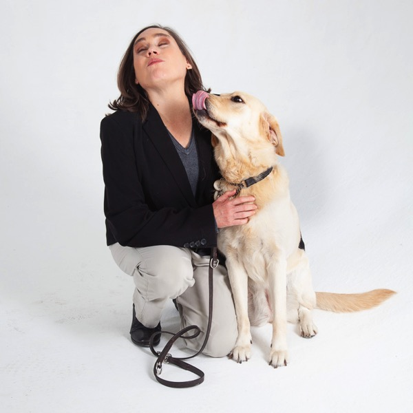 The image shows Guide Dog Fiji licking Lois on the nose