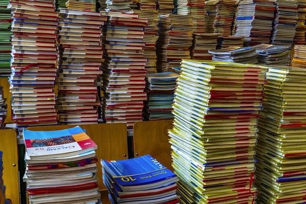 The image shows a stack of books placed one atop another